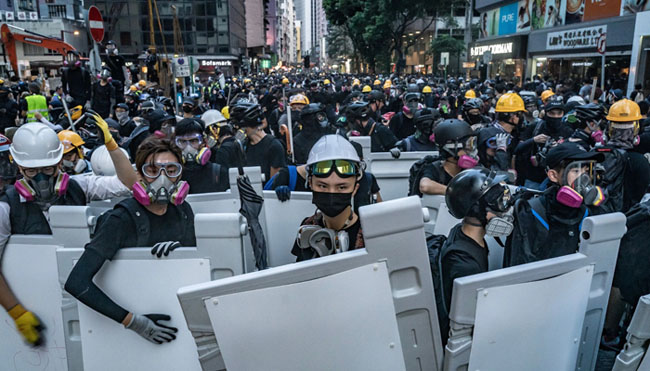 US President Donald Trump signs legislation to support pro-democracy protesters in Hong Kong