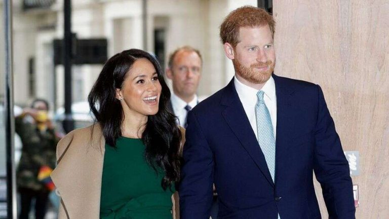 Britain's Prince Harry and his wife Meghan Markle