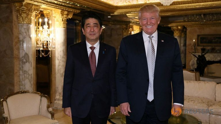 Japan's Prime Minister Shinzo Abe meets with US President-elect Trump Donald