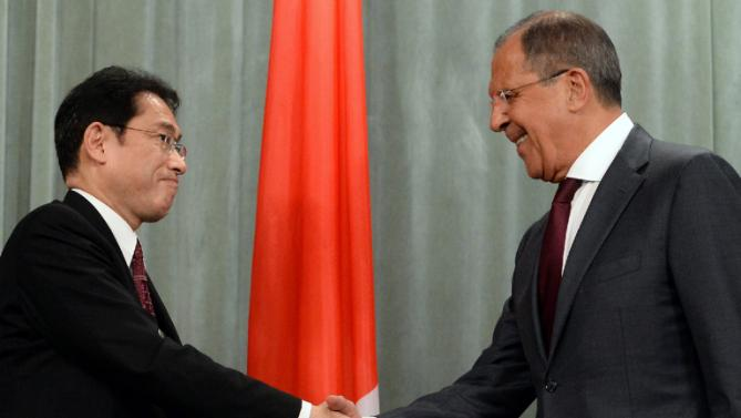 Japan's Foreign Minister Fumio Kishida, and the Russian Foreign Minister Sergei Lavrov