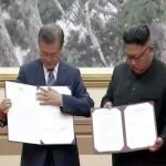 South Korean President Moon Jae-in meets North Korea's leader Kim Jong Un, sign the agreements