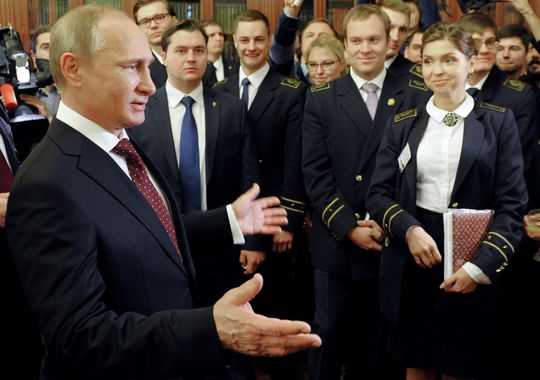 Russian President Putin in St Petersburg university students speaking staff