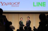 Z Holdings President Kentaro Kawabe and Line President Takeshi Idezawa