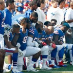Buffalo Bills players take a knee during the playing of the national anthem