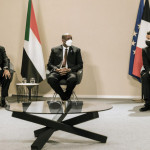 French President Emmanuel Macron attends the ceremony with Sudanese Prime Minister Abdullah Hamdouk and military ruler General Abdel Fattah Burhan.