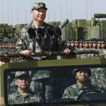President Xi Jinping wearing military dressed on a military car last day inspected 12,000 soldiers' parade