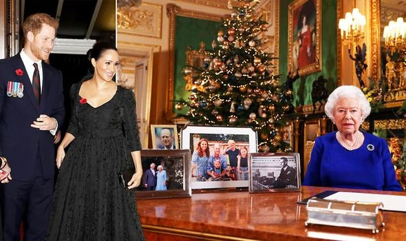 Queen Elizabeth is seen sitting behind a table while 4 framed pictures of royal family members are placed on the table.