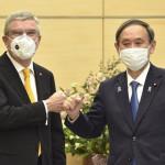 Prime Minister Suga Yoshihide and IOC chief Thomas Bach
