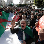 Thousands protest in Algeria, hours before polling begins