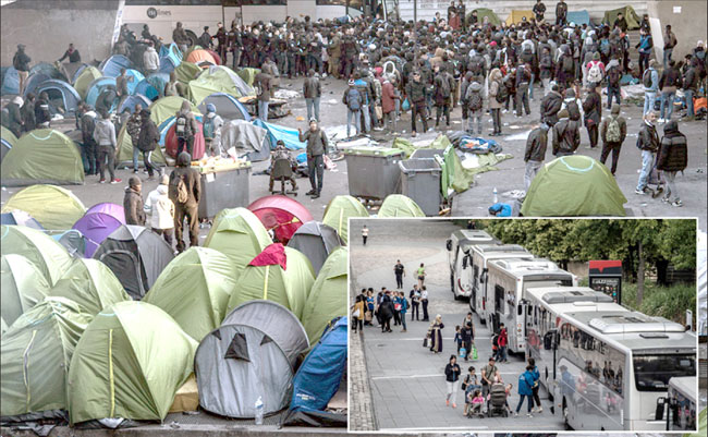 Police officers evacuate illegal tents and move migrants