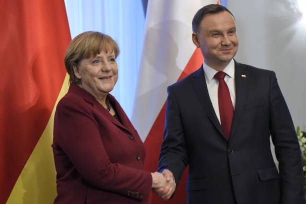 Polish President Andrzej Duda and German Chancellor Angela Merkel