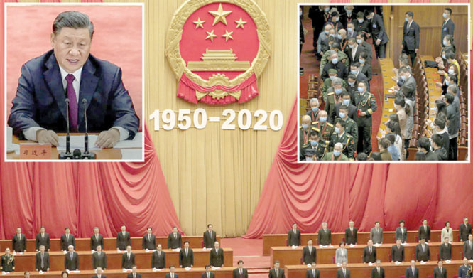 Members of the People's Congress stand up and pay tribute to the soldiers who fought in the Korean War. President Xi addresses the ceremony.