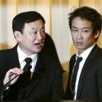 Former Thai Prime Minister Thaksin Shinawatra with his son Panthongtae Shinawatra
